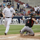 New York Yankees Corban Joseph, left, scores a run as Miami Marlins catcher Jeff Mathis waits for the ball during the fifth inning of a Legend Series exhibition baseball game in honor of Mariano Rivera, in Panama City, Sunday, March 16, 2014 The Associate