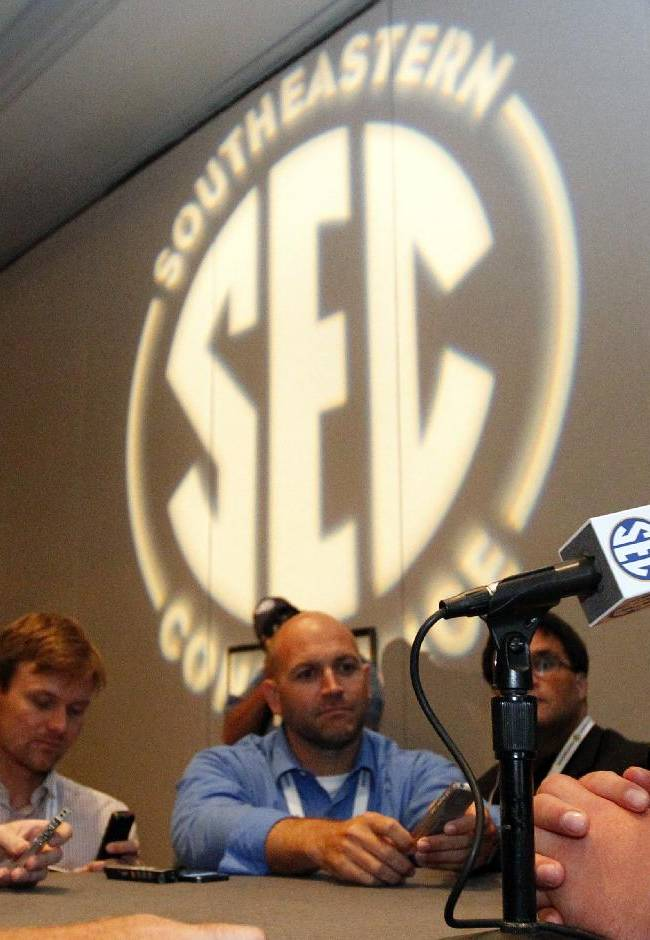 Arkansas guard Brey Cook speaks to the media at the Southeastern Conference NCAA college football media days, Wednesday, July 16, 2014, in Hoover, Ala