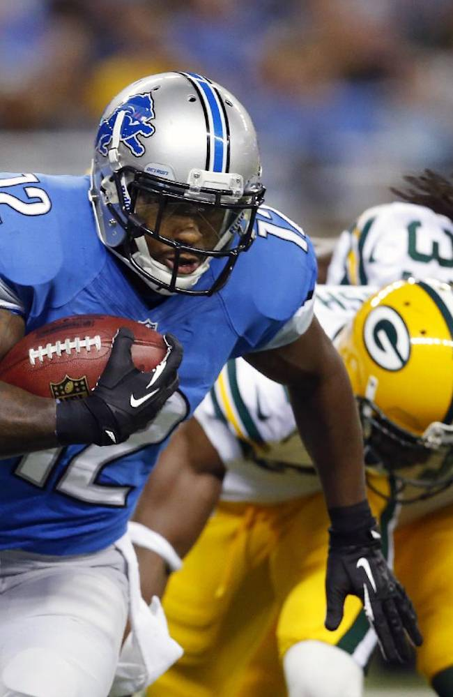 Detroit Lions wide receiver Jeremy Ross (12) pulls away from Green Bay Packers cornerback Jarrett Bush (24) and cornerback Davon House (31) during the first quarter of an NFL football game at Ford Field in Detroit, Thursday, Nov. 28, 2013