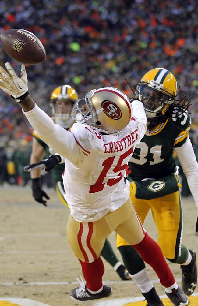 San Francisco 49ers wide receiver Michael Crabtree (15) misses a pass reception against Green Bay Packers cornerback Davon House (31) during the first half of an NFL wild-card playoff football game, Sunday, Jan. 5, 2014, in Green Bay, Wis