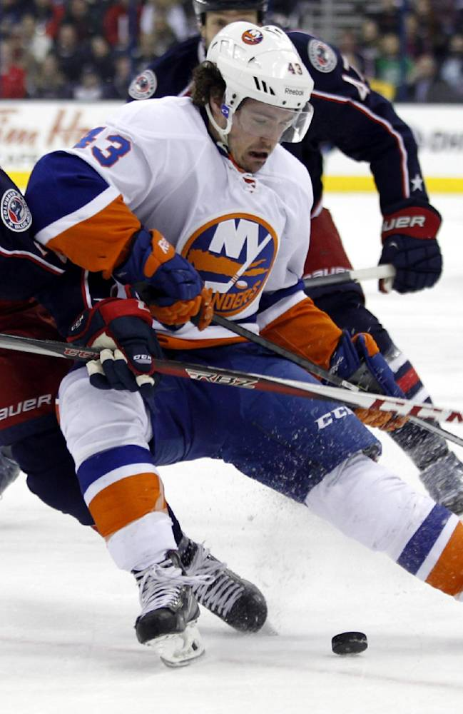 Columbus Blue Jackets' Derek MacKenzie, left, and  New York Islanders' Mike Halmo work for the puck  in the first period of an NHL hockey game in Columbus, Ohio, Sunday, April 6, 2014
