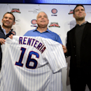 Chicago Cubs new manager Rick Renteria, center, receives a jersey from Chicago Cubs President of Baseball Operations Theo Epstein, right, and Chicago Cubs Vice President and General Manager Jed Hoyer during a press conference at Wrigley Field in Chicago,
