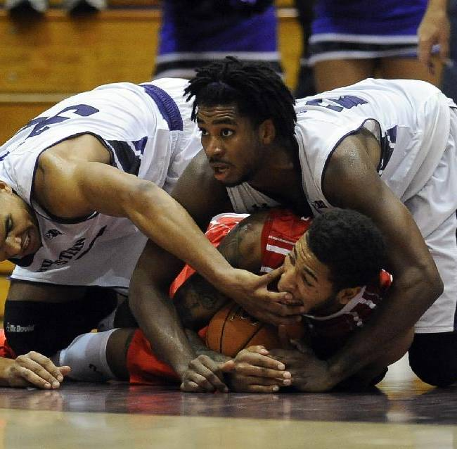 Northwestern's Sanjay Lumpkin, left, and JerShon Cobb, right, try and get the ball away from Illinois State's Michael Middlebrooks, center during the second half of an NCAA college basketball game in Evanston, Ill., on Sunday, Nov. 17, 2013