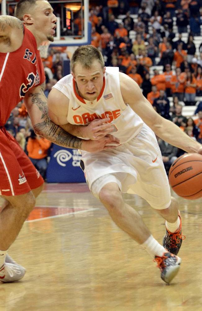 In this Nov. 18, 2013, file photo, Syracuse's Trevor Cooney, right, drives aganst St. Francis' Ben Mockford during the second half of an NCAA college basketball game in Syracuse, N.Y. Coach Jim Boeheim has a keen eye for finding those diamonds in the rough _ players he can take under his wing at Syracuse and develop over four years like Cooney
