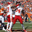 Kansas City Chiefs running back Knile Davis (34) celebrates his touchdown with teammate Donnie Avery against the Denver Broncos during the first half of an NFL football game, Sunday, Sept. 14, 2014, in Denver The Associated Press