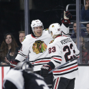 Chicago Blackhawks' Brad Richards, left, celebrates his goal with Kris Versteeg during the first period of an NHL hockey game against the Los Angeles Kings Saturday, Nov. 29, 2014, in Los Angeles The Associated Press