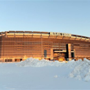 FILE - In this Feb. 9, 2013 file photo, the sun sets on the snow covered parking lot at Metlife Stadium in East Rutherford, N.J.  The 2013 season is on the horizon and so is the cold-weather Super Bowl. The title game on Feb. 2 at MetLife Stadium is less than nine months away. (AP Photo/Bill Kostroun, File)