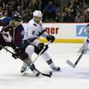 Colorado Avalanche center Maxime Talbot, left, flips the puck on net as San Jose Sharks center Joe Pavelski, center, and goalie Antti Niemi, of Finland, cover in the third period of the Sharks' 3-2 shootout victory in an NHL hockey game in Denver on Tuesd