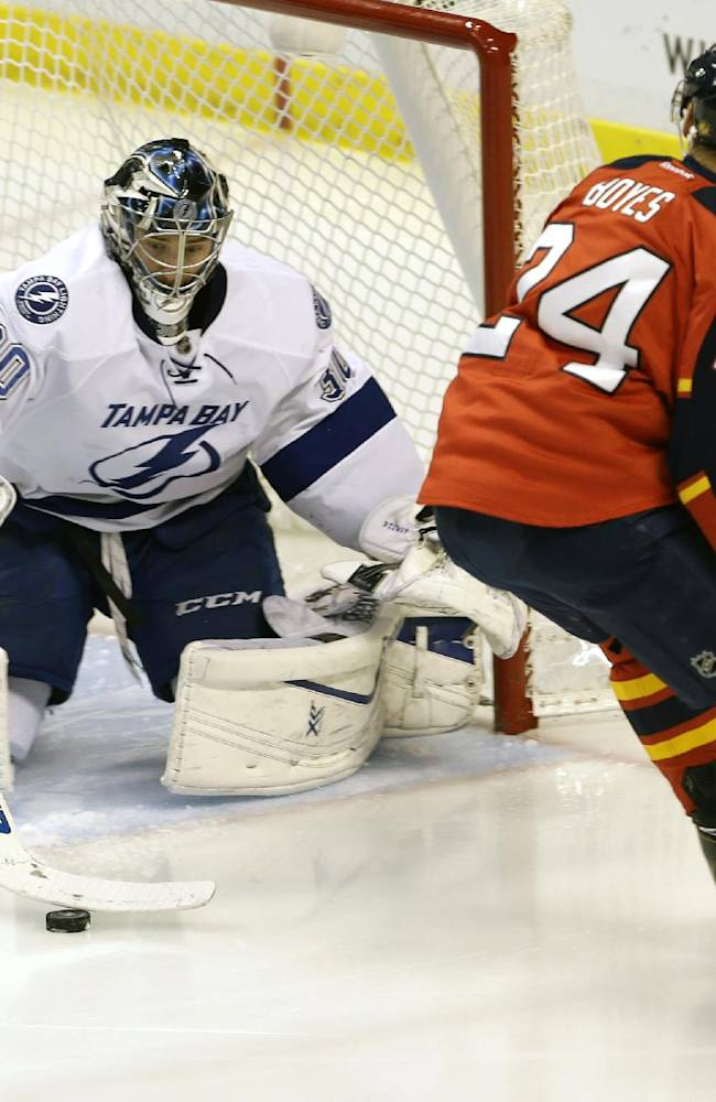 Tampa Bay Lightning goalie Ben Bishop (30) stops a shot by Florida Panthers right wing Brad Boyes (24) during the second period of an NHL hockey game in Sunrise, Fla., Monday, Dec. 23, 2013