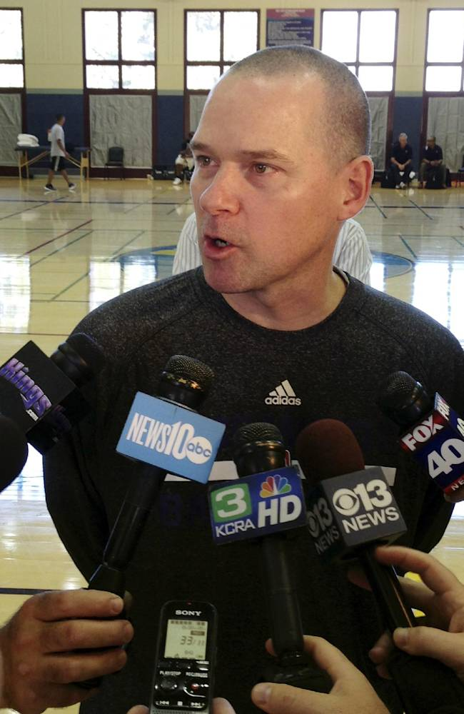 Sacramento Kings coach Mike Malone speaks with the media after the first practice of NBA basketball training camp on Tuesday, Oct. 1, 2013, in Santa Barbara, Calif. The Kings are hoping their successful summer leads to more victories this season with a new coaching staff, front office and ownership group