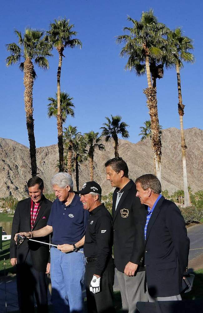 From left; Humana President & CEO Bruce Broussard, former President Bill Clinton, World Golf Hall of Famer Gary Player, Humana Challenge Executive Director Bob Marra and PGA Tour Commissioner Tim Finchem gather for a photo prior to the first round of the Humana Challenge PGA golf tournament on the Palmer Private course at PGA West, Thursday, Jan. 16, 2014, in La Quinta, Calif