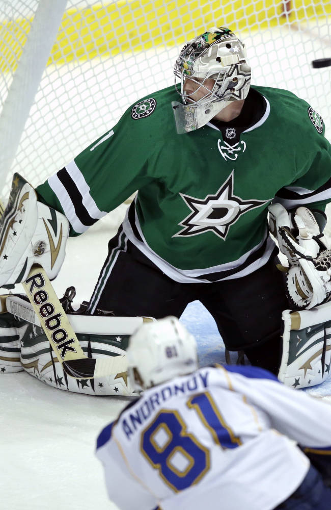 Dallas Stars goalie Jack Campbell (1) defends the goal agains St. Louis Blues right wing Sergei Andronov (81) during the second period of an NHL pre-season hockey game Sunday, Sept. 15, 2013, in Dallas