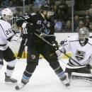 San Jose Sharks left wing T.J. Galiardi (21) has his shot deflected by Los Angeles Kings goalie Jonathan Quick, right, as defenseman Slava Voynov, of Russia, left, watches during the first period in Game 4 of their second-round NHL hockey Stanley Cup playoff series in San Jose, Calif., Tuesday, May 21, 2013. (AP Photo/Marcio Jose Sanchez)
