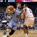 Memphis Grizzlies' Marc Gasol (33), of Spain, drives past Phoenix Suns' Channing Frye (8) during the first half of an NBA basketball game, Monday, April 14, 2014, in Phoenix The Associated Press