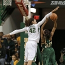 Baylor center Brittney Griner (42) blocks a shot attempt by Southeastern Louisiana's Nanna Pool (30) in the first half of NCAA college basketball game Saturday, Dec. 29, 2012, in Waco, Texas. (AP Photo/Tony Gutierrez)