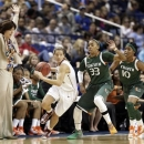 Miami head coach Katie Meier, left, jumps out of the way as Florida State's Alexa Deluzio, second from left, is chased by Miami's Suriya McGuire, second from right, and Michelle Woods, right, during the first half of an NCAA college basketball game at the Atlantic Coast Conference tournament in Greensboro, N.C., Friday, March 8, 2013. (AP Photo/Chuck Burton)