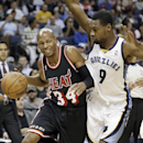 Miami Heat guard Ray Allen (34) drives around Memphis Grizzlies guard Tony Allen (9) in the first half of an NBA basketball game Wednesday, April 9, 2014, in Memphis, Tenn The Associated Press