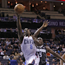 Charlotte Bobcats' Ben Gordon (8) drives past Orlando Magic's Victor Oladipo (5) during the first half of an NBA basketball game in Charlotte, N.C., Wednesday, Dec. 11, 2013 The Associated Press