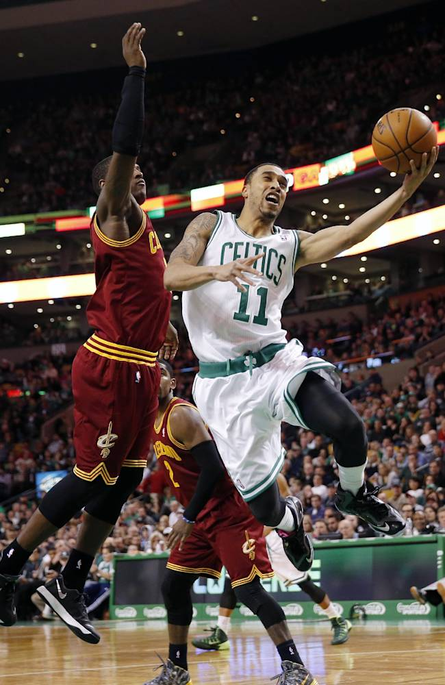 Boston Celtics' Courtney Lee (11) goes up to shoot in front of Cleveland Cavaliers' Dion Waiters (3) in the fourth quarter of an NBA basketball game in Boston, Saturday, Dec. 28, 2013. The Celtics won 103-100