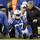 In this Oct. 20, 2013, file photo, Indianapolis Colts wide receiver Reggie Wayne (87) talks to trainers after he injured his knee during the second half of an NFL football game against the Denver Broncos in Indianapolis. The last time Wayne played in a r