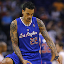 Los Angeles Clippers' Matt Barnes gestures to his bench after hitting a three pointer against the Phoenix Suns during the second half of an NBA basketball game, Tuesday, March 4, 2014, in Phoenix. The Clippers won 104-96 The Associated Press