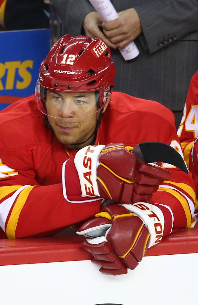 Jarome Iginla #12 of the Calgary Flames and Jiri Hudler #24 look on from the bench during their NHL game against the Vancouver Canucks at the Scotiabank Saddledome on March 3, 2013 in Calgary, Alberta, Canada. (Photo by Tom Szczerbowski/Getty Images)