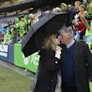 Seattle Sounders head coach Sigi Schmid, right, kisses his wife Valerie under an umbrella after the Sounders beat the Los Angeles Galaxy 2-0 in an MLS soccer match, Saturday, Oct. 25, 2014, in Seattle The Associated Press