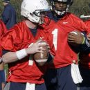 FILE - In this March 26, 2012, file photo, Penn State quarterback Matt McGloin, left, and Rob Bolden (1) participate in a drill during the first day of spring NCAA college football practice in State College, Pa. Healthy again after missing last season's bowl game, McGloin is busy this summer digesting an NFL-type playbook in preparation for the Nittany Lions' first season under coach Bill O'Brien. (AP Photo/Gene J. Puskar, File)