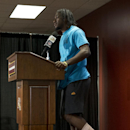 Washington Redskins quarterback Robert Griffin III speaks while standing on one foot during a media availability after an NFL football game against the Jacksonville Jaguars, Sunday, Sept. 14, 2014, in Landover, Md. The Redskins won 41-10. Griffin injured his left ankle. (AP Photo/Evan Vucci)
