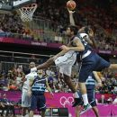 Argentina's Carlos Delfino, right, stops Nigeria's Al-Farouq Aminu on a drive to the basket during a men's basketball game at the 2012 Summer Olympics, Saturday, Aug. 4, 2012, in London. (AP Photo/Charles Krupa)