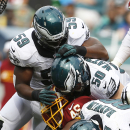 Washington Redskins running back Alfred Morris (46) is sandwiched between Philadelphia Eagles outside linebacker Connor Barwin (98), Casey Matthews (50) and DeMeco Ryans (59) during the second half of an NFL football game, Sunday, Sept. 21, 2014, in Phila
