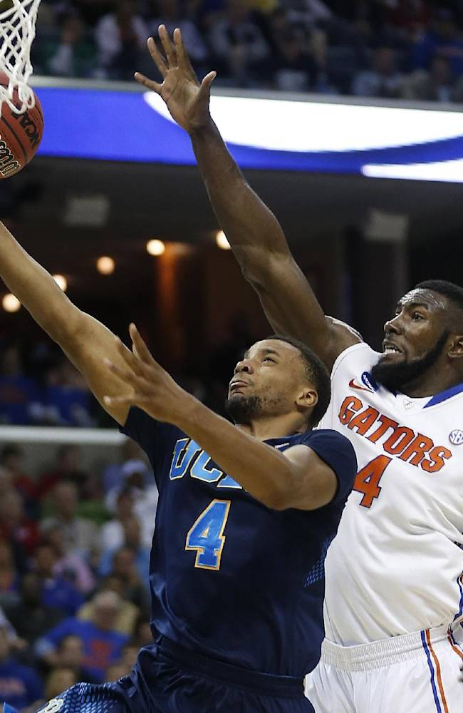 UCLA guard Norman Powell (4) shoots against Florida center Patric Young (4) during the first half in a regional semifinal game at the NCAA college basketball tournament, Thursday, March 27, 2014, in Memphis, Tenn