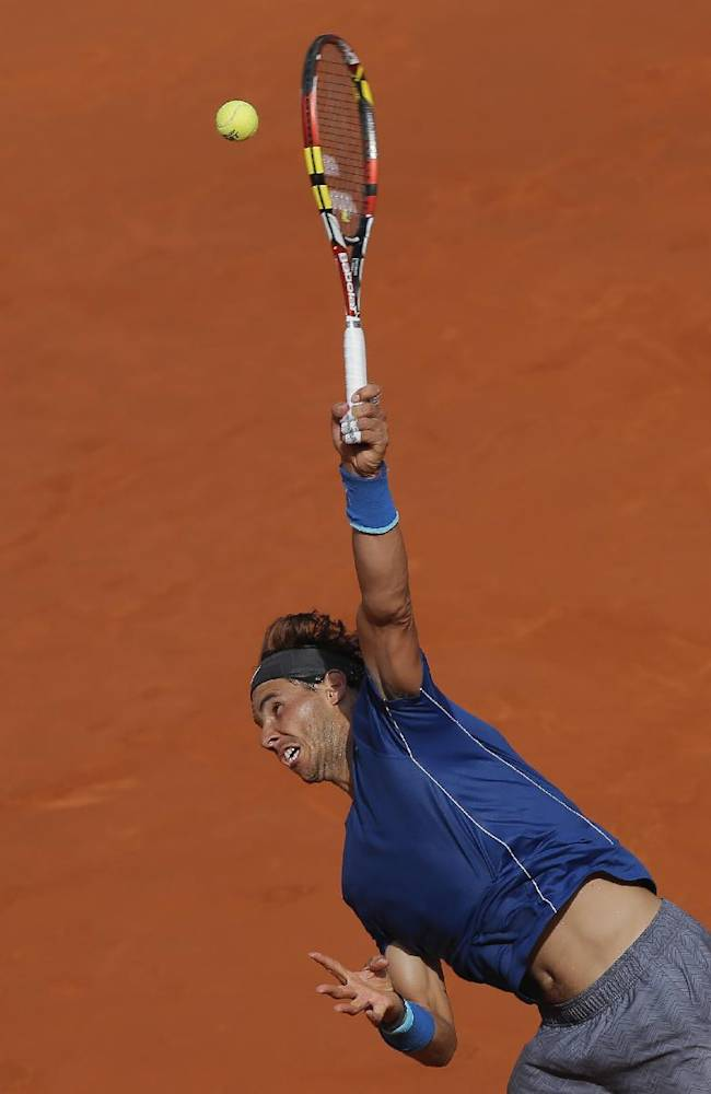 Rafael Nadal from Spain serves during a Madrid Open tennis tournament semifinal match against Roberto Bautista Agut from Spain in Madrid, Spain, Saturday, May 10, 2014