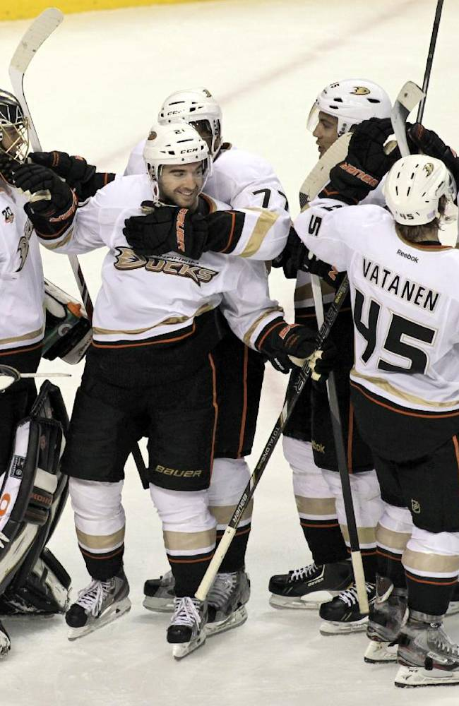 Anaheim Ducks' Kyle Palmieri (21) is mobbed by teammates after their 3-2-win over the Philadelphia Flyers in an NHL hockey game, Tuesday Oct. 29, 2013, in Philadelphia. Palmieri scored two straight goals in the third period to rally the Ducks past the Flyers 3-2