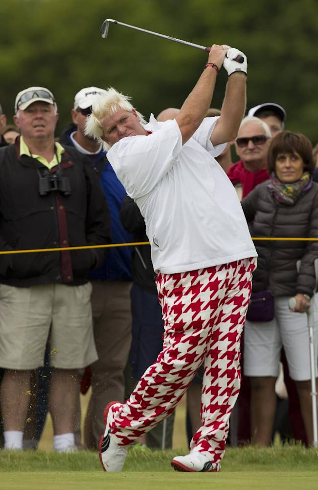 John Daly of the US plays a shot off the 17 tee during a practice round at the Royal Liverpool Golf Club prior to the start of the British Open Golf Championship, in Hoylake, England, Monday, July 14, 2014. The 2014 Open Championship starts on Thursday, July 17