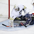Pittsburgh Penguins' Thomas Greiss (1) blocks a shot by Columbus Blue Jackets' Matt Calvert (11) with his stick during the second period of an NHL hockey game in Columbus, Ohio Saturday, Dec. 13, 2014 The Associated Press