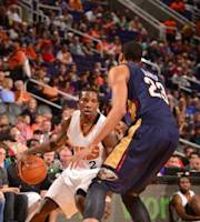 PHOENIX, AZ - NOVEMBER 10: Eric Bledsoe #2 of the Phoenix Suns drives against Anthony Davis #23 of the New Orleans Pelicans on November 10, 2013 at U.S. Airways Center in Phoenix, Arizona. (Photo by Barry Gossage/NBAE via Getty Images)