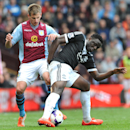 Aston Villa's Marc Albrighton, left, and Southampton's Victor Wanyama battle for the ball during the English Premier League soccer match between Aston Villa and Southampton at Villa Park, in Birmingham, England, Saturday, April 19, 2014