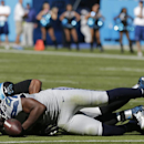 Seattle Seahawks defensive end Cliff Avril (56) recovers a fumbled ball by Carolina Panthers quarterback Cam Newton (1) as Carolina Panthers running back Jonathan Stewart (28) vies for thew ball during the first half of an NFL football game, Sunday, Oct.