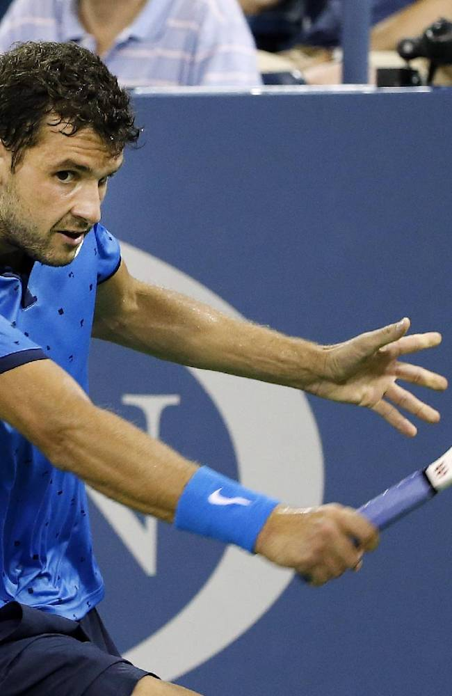 Grigor Dimitrov, of Bulgaria, returns a shot to David Goffin, of Belgium, during the third round of the U.S. Open tennis tournament Sunday, Aug. 31, 2014, in New York