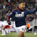 New England Revolution's Charlie Davies (9) celebrates his goal against the New York Red Bulls during the second half of the second soccer game of the MLS Eastern Conference final in Foxborough, Mass., Saturday, Nov. 29, 2014. The match ended 2-2 and New England advanced to the MLS Cup with a two-game aggregate 4-3. (AP Photo/Elise Amendola)