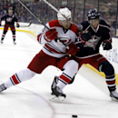 Carolina Hurricanes' Brett Bellemore, left, and Columbus Blue Jackets' Matt Calvert work for the puck in the second period of an NHL hockey game in Columbus, Ohio, Tuesday, March 18, 2014 The Associated Press