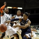 Penn State's Dara Taylor makes the pass as Miami's Suriya McGuire, left, defends during the first half of an NCAA women's college basketball game in Miami, Thursday, Nov. 29, 2012. (AP Photo/Jeffrey M. Boan)