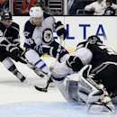 Winnipeg Jets right wing Blake Wheeler (26) scores a goal against Los Angeles Kings goalie Jonathan Quick (32) as Los Angeles Kings defenseman Slava Voynov (26) defends during the third period of an NHL hockey game at the Staples Center Saturday, March 29