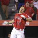 Los Angeles Angels' Hank Conger is hit by a pitch with the bases loaded to force Raul Ibanez to score the game winning run during the 11th inning of a baseball game against the New York Mets on Friday, April 11, 2014, in Anaheim, Calif. The Angels won 5-4