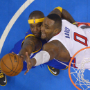 Golden State Warriors center Jermaine O'Neal, left, battles for a rebound with Los Angeles Clippers forward Glen Davis during the second half in Game 1 of an opening-round NBA basketball playoff series, Saturday, April 19, 2014, in Los Angeles. The Warrio