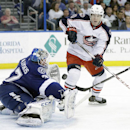 Tampa Bay Lightning goalie Kristers Gudlevskis (37), of Latvia, makes a save on a shot by Columbus Blue Jackets left wing Matt Calvert (11) during the third period of an NHL hockey game Friday, April 11, 2014, in Tampa, Fla. The Lightning won the game 3-2