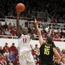Stanford forward Chiney Ogwumike (13) takes a shot over Oregon forward Liz Brenner (15) during the first half of an NCAA college basketball game in Stanford, Calif., Sunday, Feb. 24, 2013. (AP Photo/Tony Avelar)