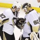 Pittsburgh Penguins' Sidney Crosby congratulates goaltender Tomas Vokoun on a 7-3 victory over the Ottawa Senators following NHL hockey playoff action in Ottawa, Ontario, Wednesday, May 22, 2013. (AP Photo/The Canadian Press, Adrian Wyld)