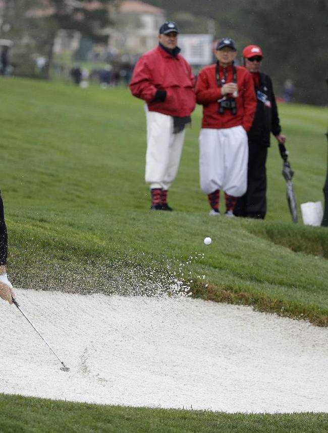 Stuart Appleby, of Australia, hits the ball out of a bunker down to the eighth green of the Pebble Beach Golf Links during the second round of the AT&T Pebble Beach Pro-Am golf tournament on Friday, Feb. 7, 2014, in Pebble Beach, Calif
